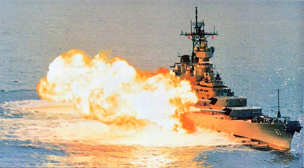 The USS Missouri firing a broadside